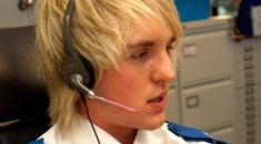 a young blonde man with a headset on