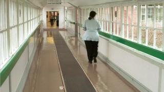Nurse in corridor. Insight