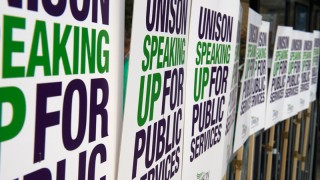 UNISON speaking up for public services placards tied to railing