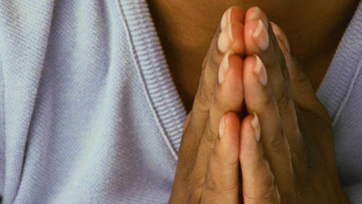 Hands held in prayer