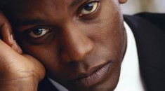 Serious looking young black man. Royalty free
