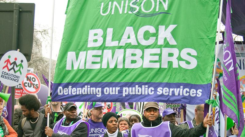 UNISON Black Members delegation holding UNISON banner