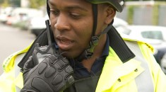 a male police community support officer on a radio