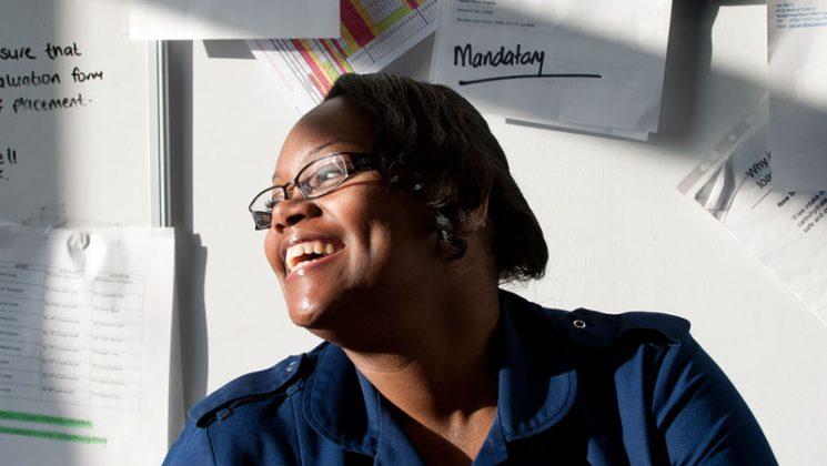 nurse smiling in sunny room