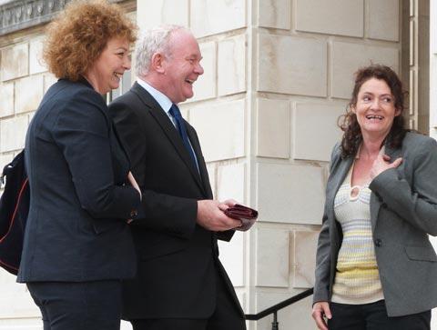 Deputy first minister Martin McGuinness receives an empty purse