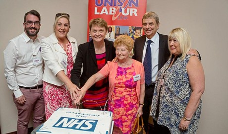 Dave Prentis, Yvette Cooper and Labour Link delegates cut a Happy 65th Birthday NHS cake
