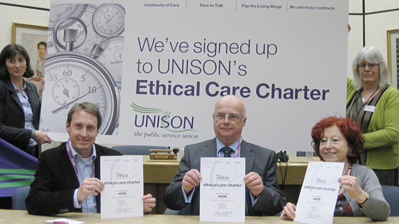 Andrew Pickup and Bob Pitt of Optalis sign the charter with UNISON head of local government Heather Wakefield