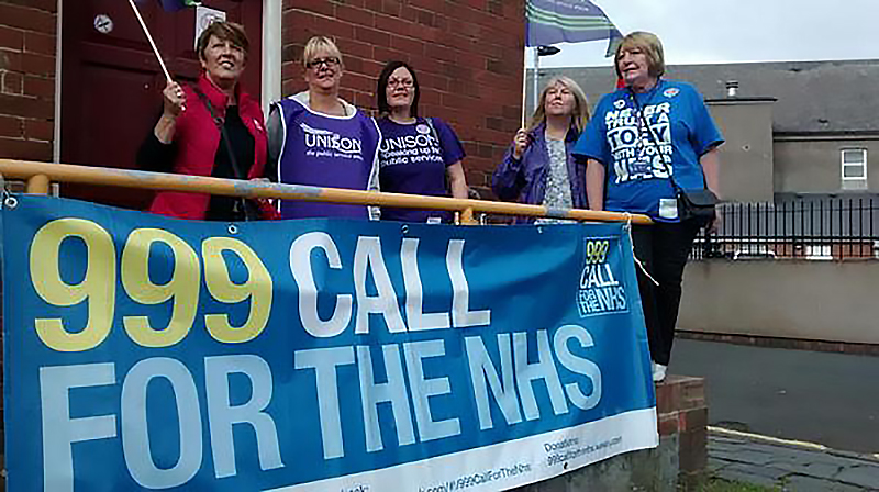 UNISON members with the 999 call for the NHS banner