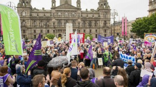 UNISON members march on George Square from there National Delegate Conference being held at the SEEC in Glasgow. 18Th June, 2015