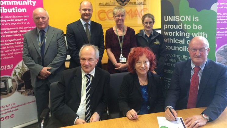 UNISON and Cormac representatives with signed charter