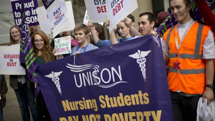 student nurses hold a banner