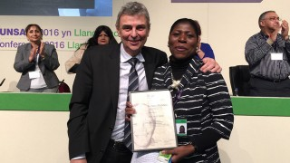 Co-chair of the UNISON national Black members' committee, Margaret Greer, receives the union's inaugural Nelson Mandela Award from general secretary Dave Prentis for her services to fighting against racism and injustice, at the 2016 Black members' conference in Llandudno.