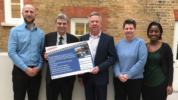 Dave Prentis was joined by activists as he signed UNISON up to the mental health initiative, Blue Light. Photo: Amanda Kendal