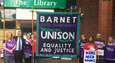 General secretary Dave Prentis with striking members and the Barnet UNISON banner outside The Library, in Barnet, north London