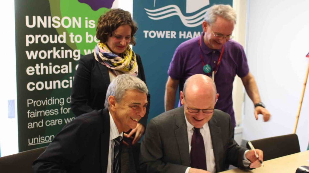 signing the charter in Tower Hamlets