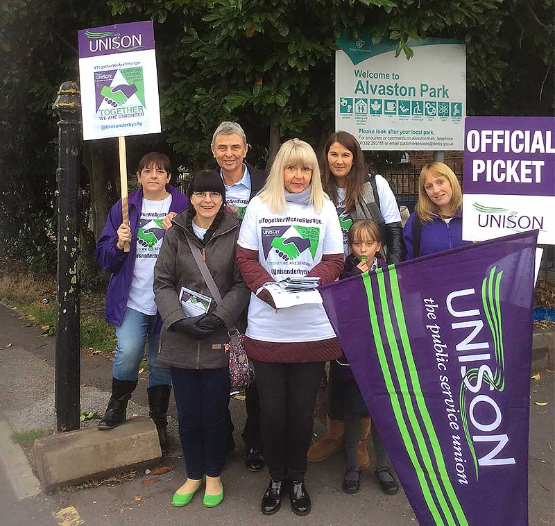 Striking teaching assistants and general secretary Dave Prentis outside a school in Derby