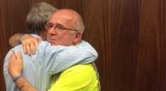 Dave Prentis hugs a member at the Redditch Time to Talk session
