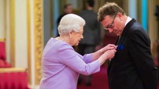Mark White receives his OBE from the Queen