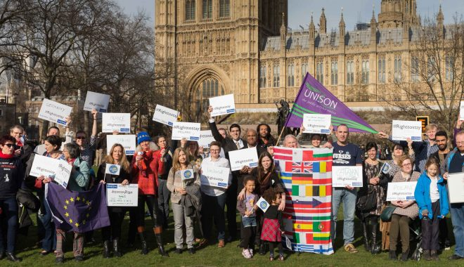 UNISON members who are citizens of other EU countries line up on Parliament Square, Westminster, with #Righttostay placards