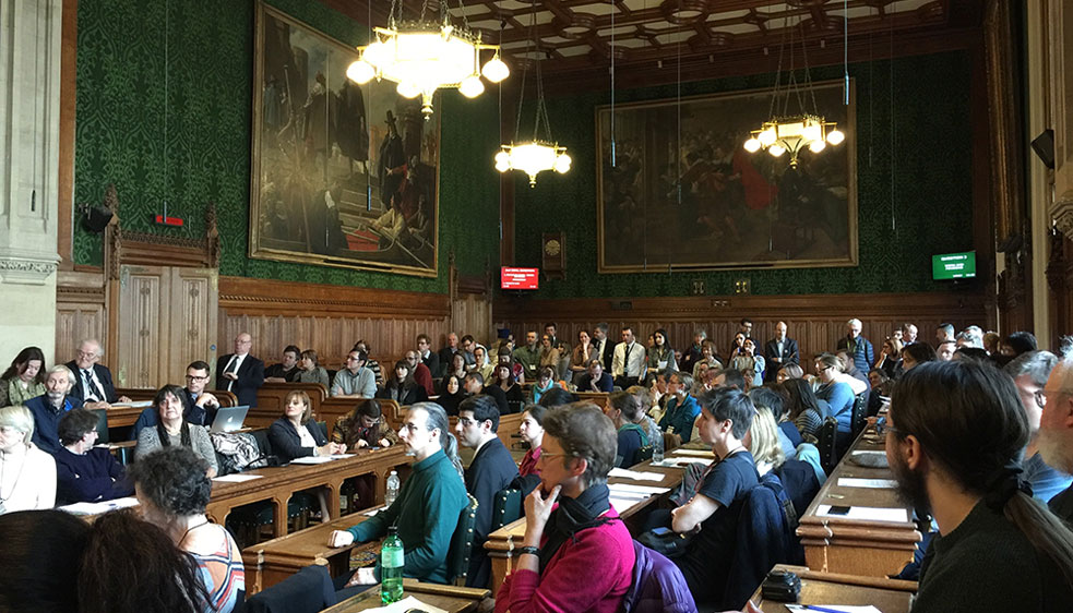 Photo of a full committee room in the Houses of Parliament as UNISON members and others who are citizens of other EU countries lobby their MPs