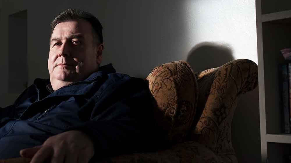 Photo of Gary Burgon at home on a couch