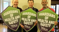 Three health and safety reps with our Guardians of Health and Safety shields