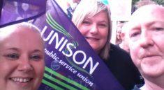 Becky Everett, Jill Goodale and Jon Richards with UNISON flag