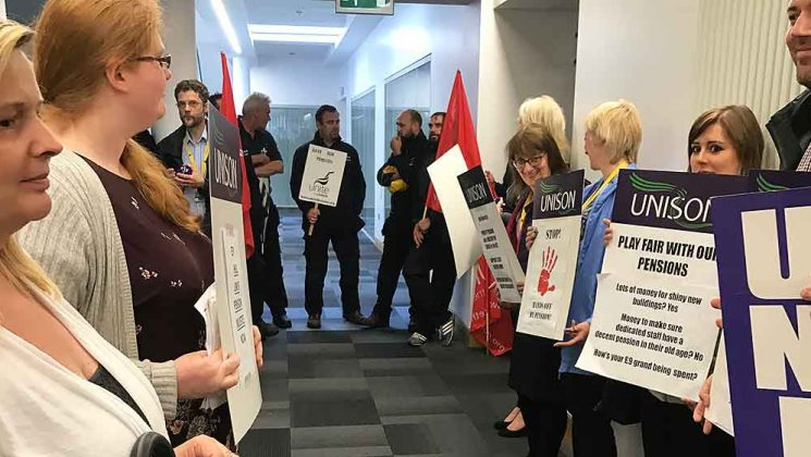 UNISON and Unite members line a corridor as part of a protest against pension changes at Hull university
