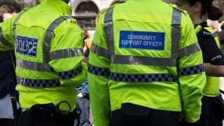 Photograph of police officers and PCSOs in high vis jackets