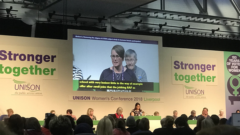 photograph of unison women's conference debating STEM education