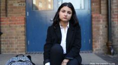 Picture of girl sitting on school steps