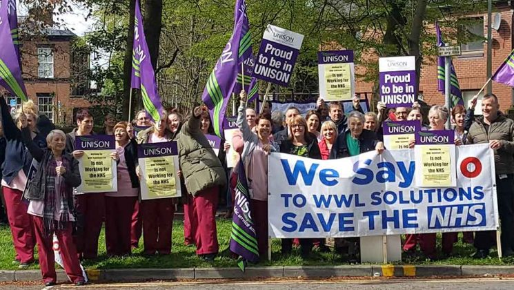 NHS trust workers demonstrating against the plans