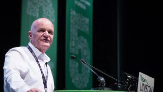 Glen Williams at rostrum addressing confernece