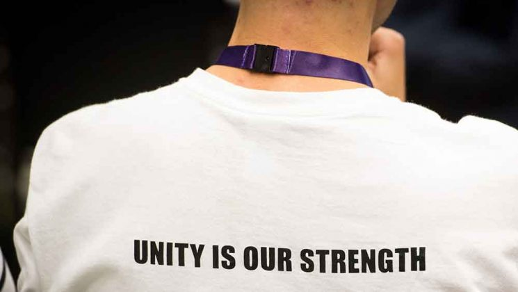Delegate's t shirt with slogan: unity is our strength