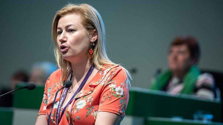 Josie Bird speaking at conference