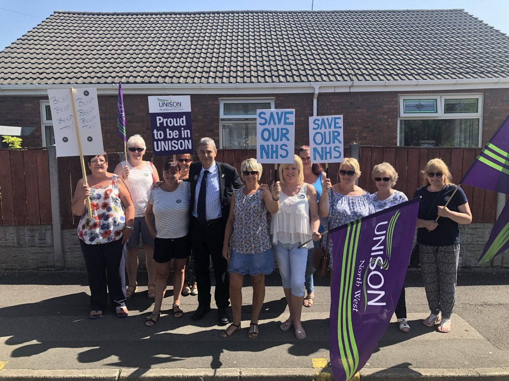 Dave Prentis plus members with flags and banners on the picket line