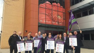 Torus housing workers protesting with placards outside one of its offices