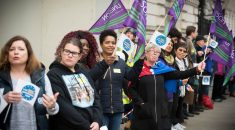 Attendees at the EU Citizens Lobby holding UNISON flags