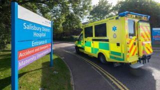 Photo of entrance to Salisbury district hospital, with ambulance in the driveway