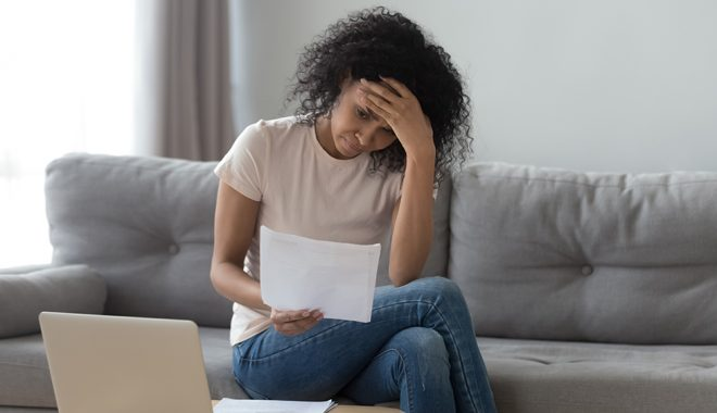 Stressed Woman Holding Bills Worried About Bankruptcy Ba