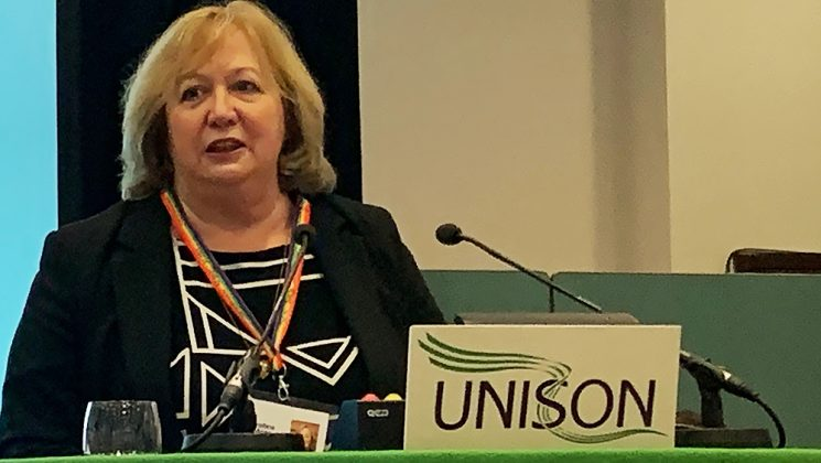 Christina McAnea speaking at the rostrum at UNISON higher education conference