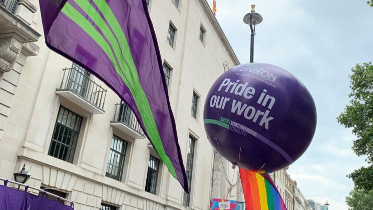 A UNISON Pride in our Work balloon and flags
