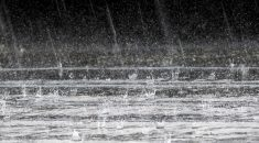 Photo of heavy rain bouncing on a roof