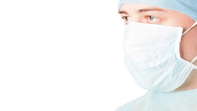 Photo of male healthworker in mask and cap
