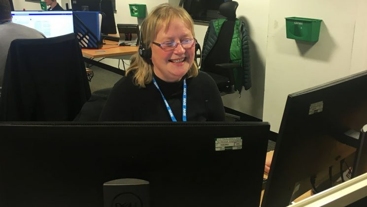 Photo of Stella Quentin at work in an NHS11 call centre