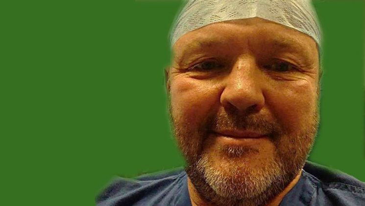 Paul Pearson in scrubs and cap
