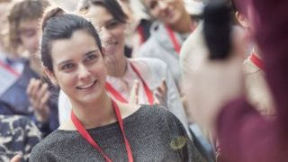 smiling young female delegate at TUC congress