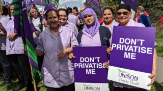 Frimley health branch members on a protest with UNISON placards and flags