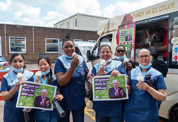 domestic services staff at Luton and Dunstable Hospital enjoy ice creams and hold 'all eyes on Boris' placards