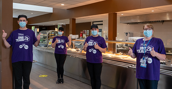 Catering staff at Hinchingbrooke Hospital in Cambridgeshire wearing their One Team 2K t-shirts